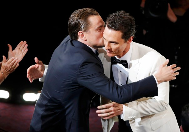 "McConaughey, best actor winner for his role in ""Dallas Buyers Club"", is congratulated by best actor nominee DiCaprio at the 86th Academy Awards in Hollywood"