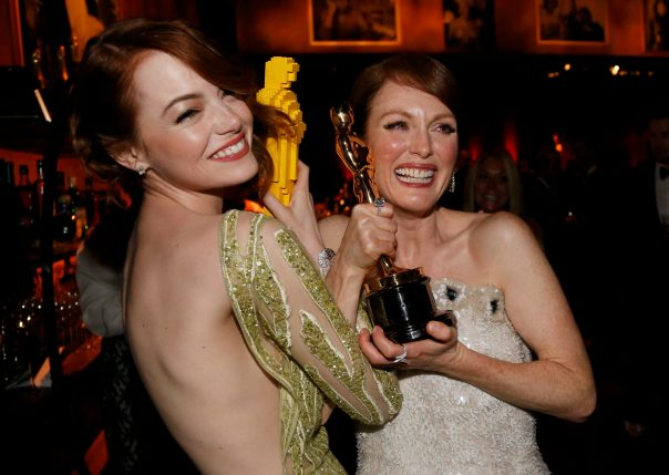 "Actress Stone compares her Lego Oscar statuette with actress Moore's genuine Oscar for best leading actress for her role in ""Still Alice"" at the Governors Ball following the 87th Academy Awards in Hollywood"